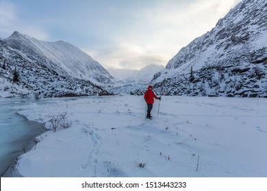 Winter, sunset, the ice kingdom of Belukha Mountain, lakes frozen in the mountains at sunset, Altai mountains