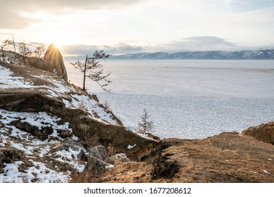 Winter sunset landscape of lake Baikal on Olkhon island. Mountains of snow and ice. Unique nature reserve in Russia