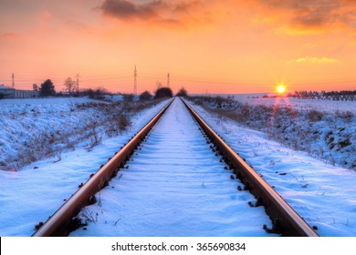 Winter sunset on the abandoned railway tracks - HDR Image