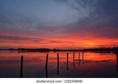 Winter sunset on the Barnegat Bay from Bonnet Island looking towards Cedar Bonnet Island in the Manahawkin Bay, New Jersey