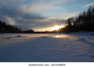 Winter sunset on the river. Russia. Kuanda.