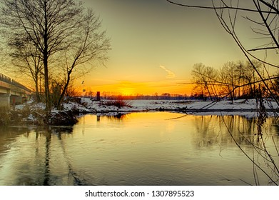 Winter sunset on the Widawka river in central Poland