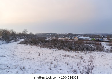 winter sunset over the frozen field