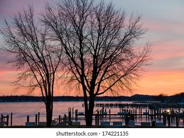 winter sunset over michigan marina