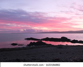 A winter sunset over the Mull of Kintyre,Argyll. Taken from the Isle of Arran,Scotland.