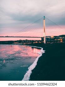Winter sunset over riverfront in Omaha, NE