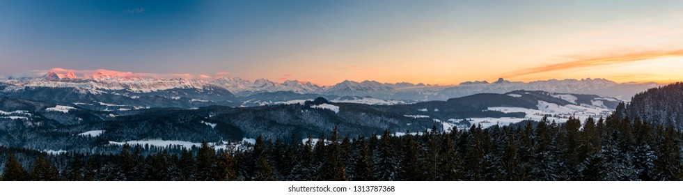 winter sunset panorama of the Bernese Alps including Eiger Mönch Jungfrau, Niesen and Stockhorn