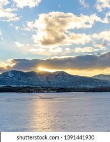 Winter Sunset - A winter sunset view of frozen Bear Creek Lake. Denver-Lakewood, Colorado, USA.