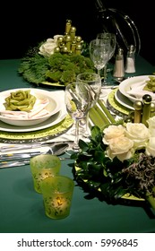 winter table with green rose decoration