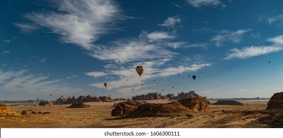 Winter at Tantora Hot Air Balloon Festival over Mada'in Saleh (Hegra) ancient site, Al Ula, Saudi Arabia