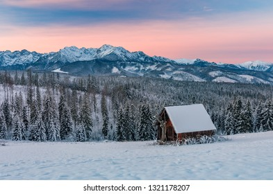 Winter Tatra mountains landscape with wooden hut in snow