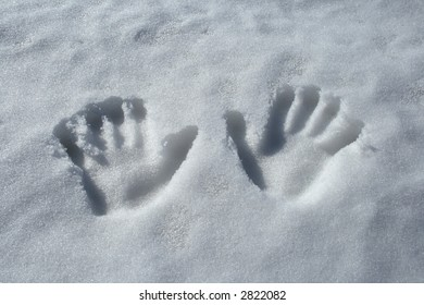 Winter theme: two handprints in the snow.