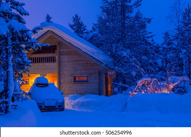 Winter thick forest. Evening. A lot of snow. A small house with lighted Windows and the car in front of the house