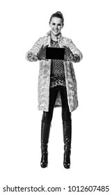 Winter things. Full length portrait of smiling trendy fashion-monger in winter coat isolated on white background showing phone blank screen