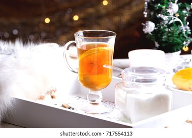 Winter time. Cup of hot tea with lemon. Cozy and soft winter background.