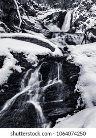 Winter time hiking to the Sanderson Brook Falls in Chester MA.  Snow and Ice cover the landscape in this large cascade.