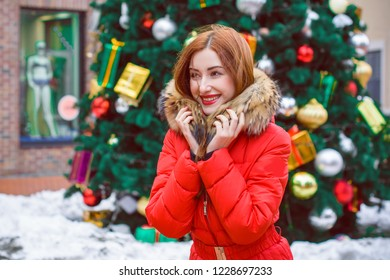 Winter time. Holidays concept, woman at cold winter, celebrate christmas at city street