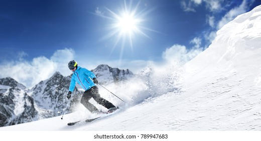 Winter time. Skier and mountains landscape