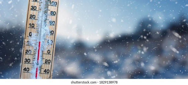 Winter time. Thermometer with blur backround  shows low temperatures