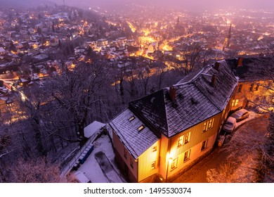 Winter time in Wernigerode. Snowfall over the historic city at night