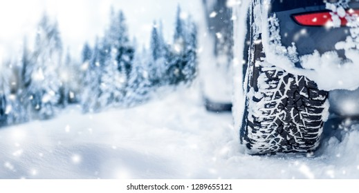 Winter tire banner or panorama detail in white snow. Car tires in snowy background..