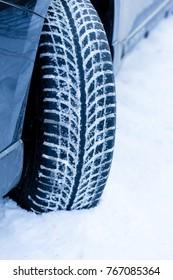 Winter tire. Closeup on SUV tire in snowy winter conditions.