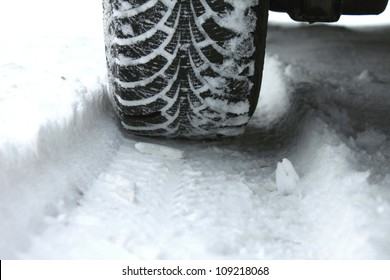 winter tire in snow closeup