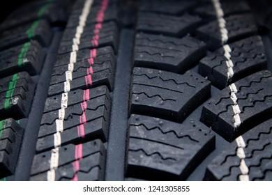 winter tire tread texture on black background