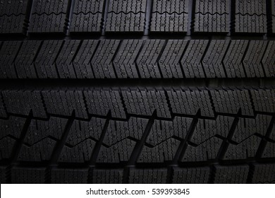 Winter tires close-up . Tyre background