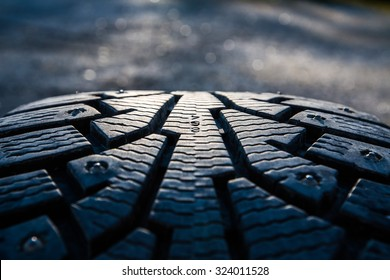 Winter tires photographed in close-up view in Finland. Focus point is in the center of the numbers. The front and back out of focus.