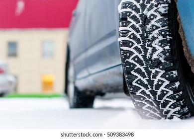 winter tires with spikes in snow