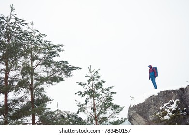 Winter tourist on the top of mountain