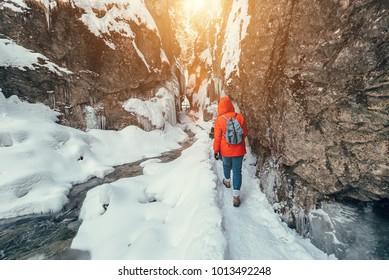 Winter traveler in snow mountain canyon