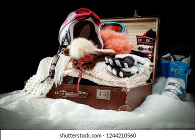 Winter trip and packed suitcase on the snow