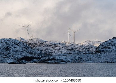 Winter turbines on mountains with snow