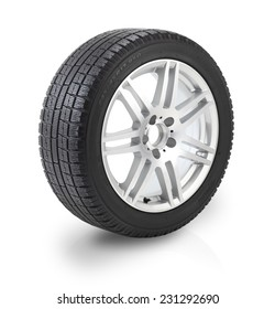 Winter tyre / Car wheel on white background. Clipping path included.