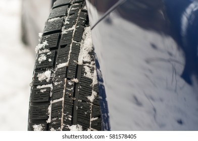 Winter tyre in the snow.