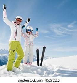 Winter vacation - Happy skiers portrait