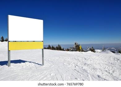 Winter vacation in mountain. Ski, Sun, Snow and fun
