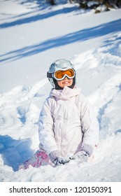 Winter vacation, ski - closeup happy skier girl playing in snow