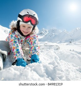 Winter vacation, ski - happy skier playing in snow