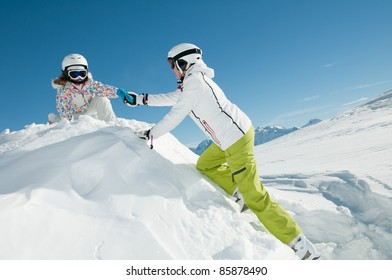 Winter vacation - skiers playing in snow