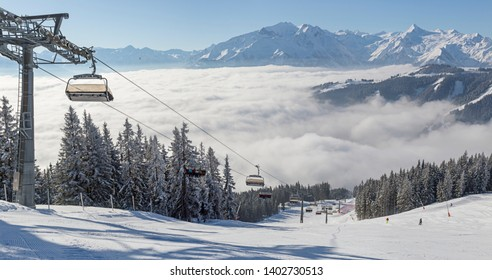 Winter view of a chair lift and ski piste at Zell Am See, Austria.