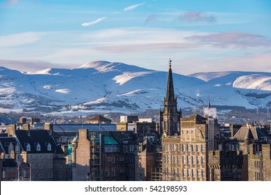 Winter view of Edinburgh's old town from the Calton Hill with the snow covered Pentaland Hills at the distance. Scotland, UK