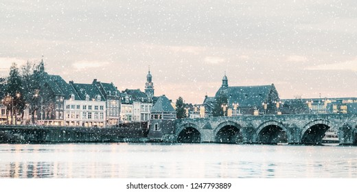 Winter view of the famous Dutch Sint Servaas bridge with lights in the city center of Maastricht