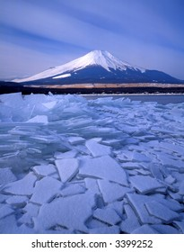 Winter view of fragmented ice on a mountain lake with Mount Fuji