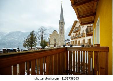 Winter View of Hallstatt, traditional austrian wood village, Lutheran Church, UNESCO world culture heritage site.