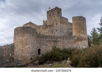 Winter view of medieval partially restored Romanesque Loarre castle near Huesca in Aragon region Spain with round towers, donjon, on top of a high rock