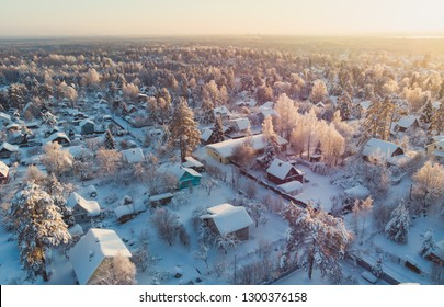 Winter view of russian country suburban village settlement, russian village, aerial sunny drone shot, near Saint-Petersburg