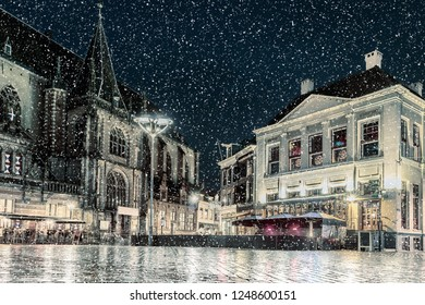 Winter view with snowfall of the Dutch central square in the city of Zwolle in december